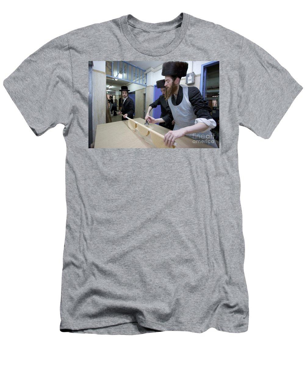 Matza Men's T-Shirt (Athletic Fit) featuring the photograph Preparing Matzah Israel by Danny Yanai
