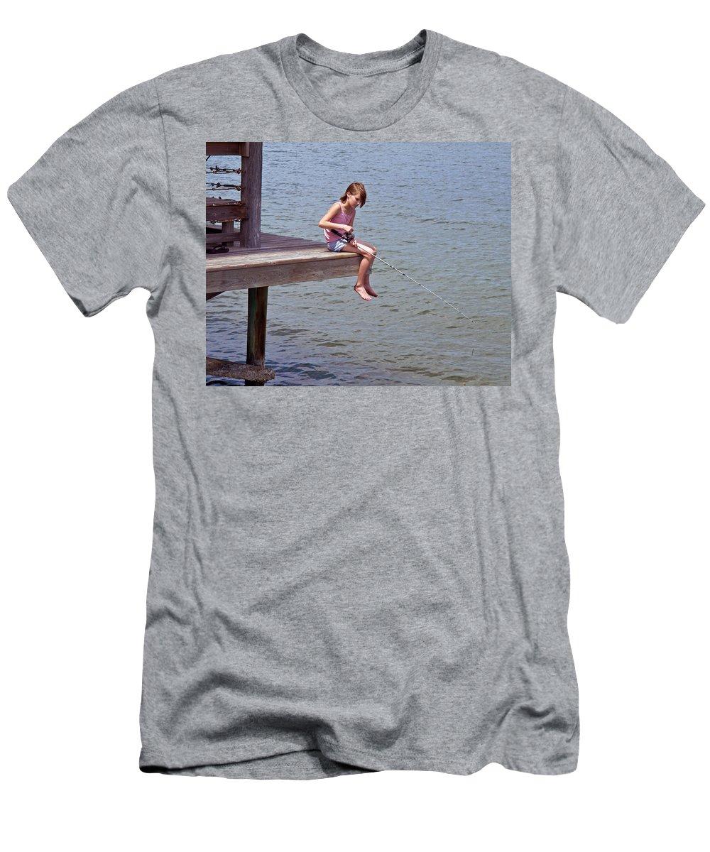 Fish; Fishing; Fisherman; Fisherwoman; Fishergirl; Girl; Florida; Brevard; Indian; River; Space; Coa Men's T-Shirt (Athletic Fit) featuring the photograph Serious Fishergirl On The Indian River In Florida by Allan Hughes