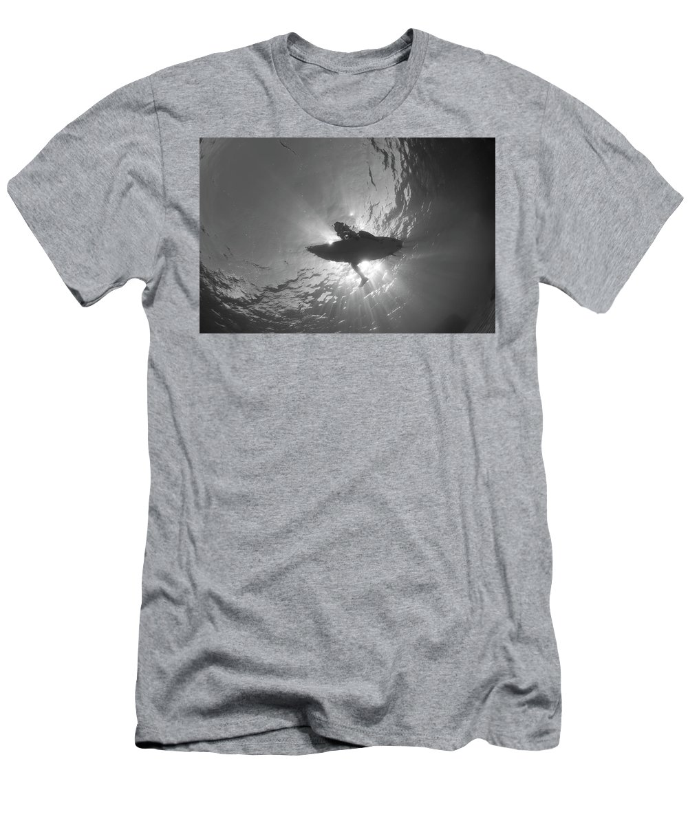 Surfer Men's T-Shirt (Athletic Fit) featuring the photograph Silhouetted by John Coffey