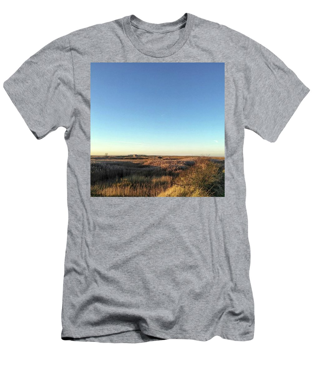 Natureonly T-Shirt featuring the photograph Thornham Marsh Lit By The Setting Sun by John Edwards
