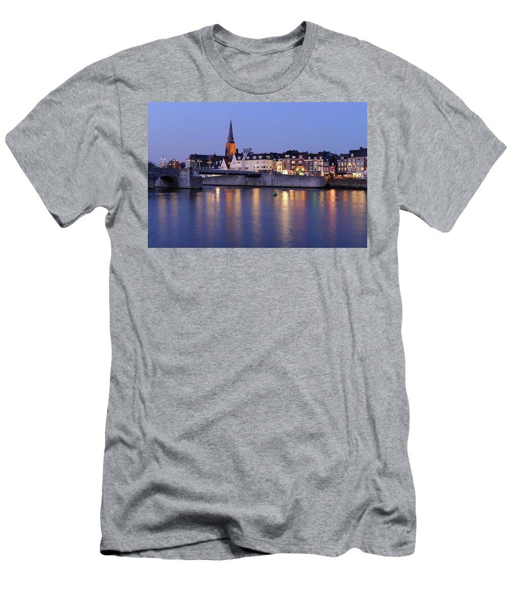 Sint Servaasbrug Men's T-Shirt (Athletic Fit) featuring the photograph Wyck In Maastricht In The Evening by Merijn Van der Vliet