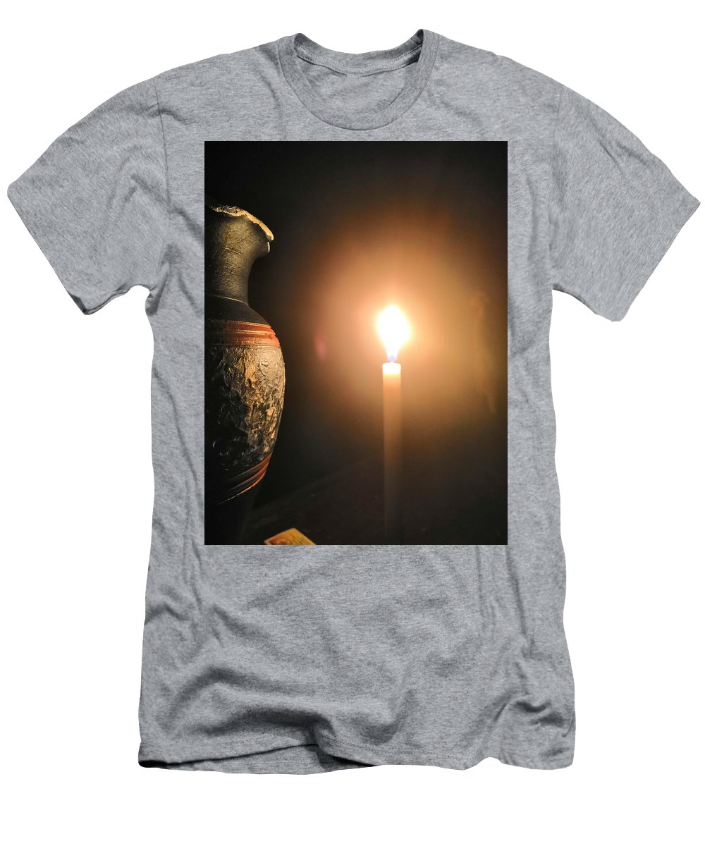 Candle Light T-Shirt featuring the photograph Light In The Dark by Ian Batanda