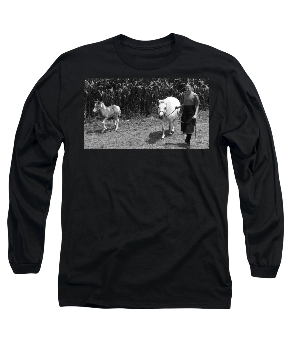 Amish Girl With Her Colt Long Sleeve T-Shirt featuring the photograph Amish Girl With Her Colt by Eric Schiabor