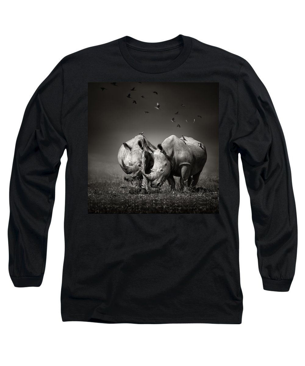 Rhinoceros Long Sleeve T-Shirt featuring the photograph Two Rhinoceros With Birds In Bw by Johan Swanepoel
