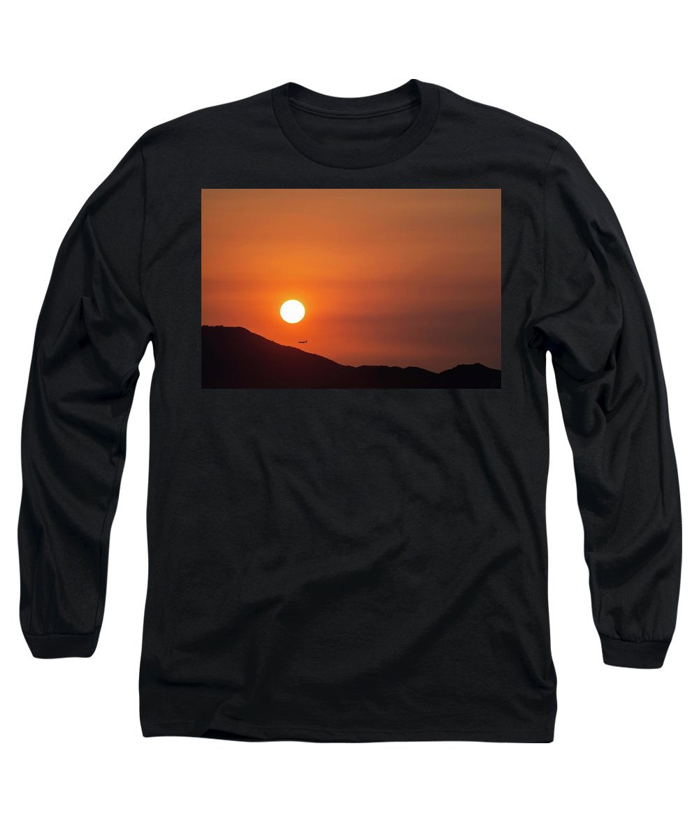Sunset Long Sleeve T-Shirt featuring the photograph Red sunset and plane in flight by Hannes Roeckel