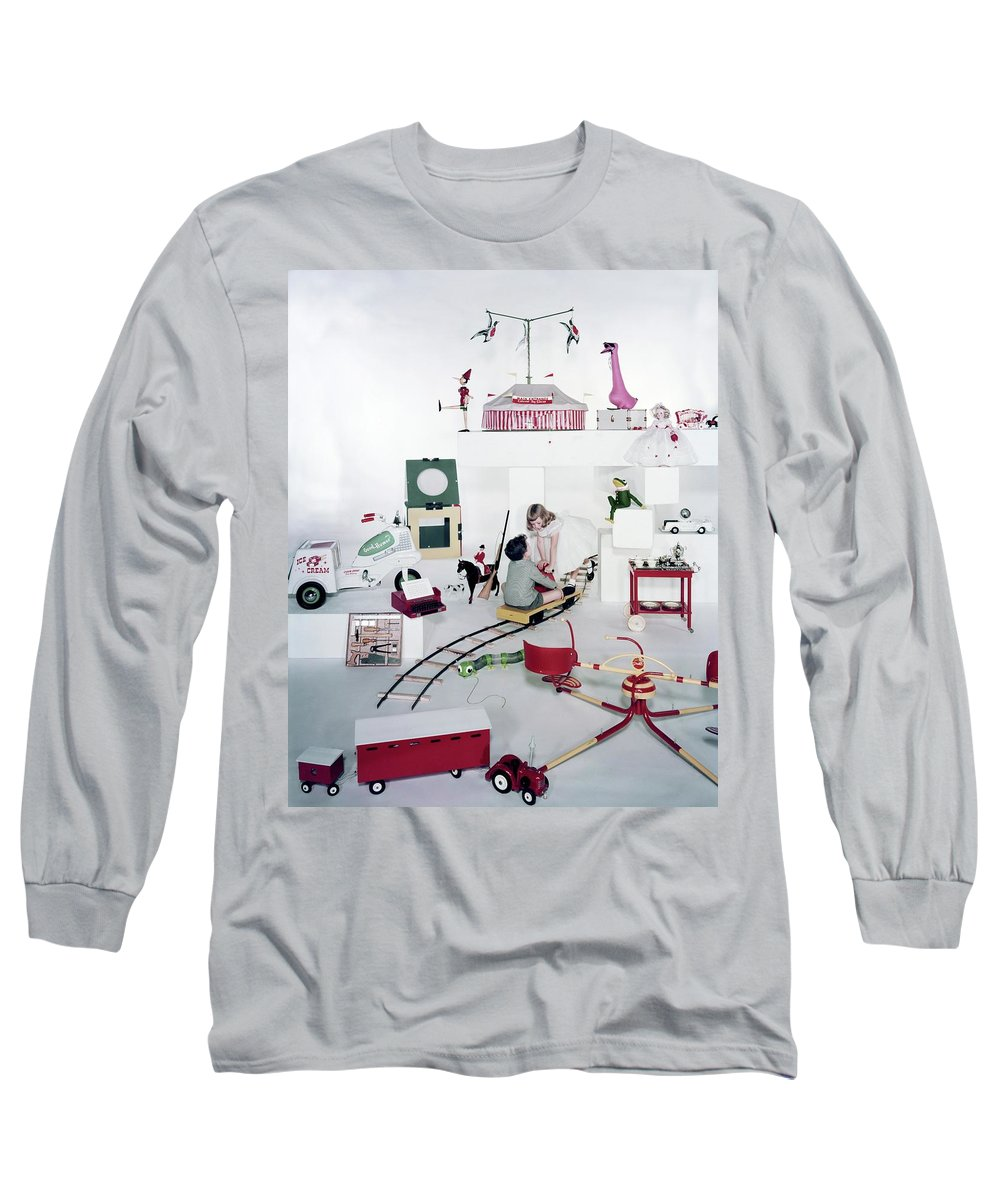 Studio Shot Long Sleeve T-Shirt featuring the photograph Two Children Playing With Vintage Toys by Bruce Knight