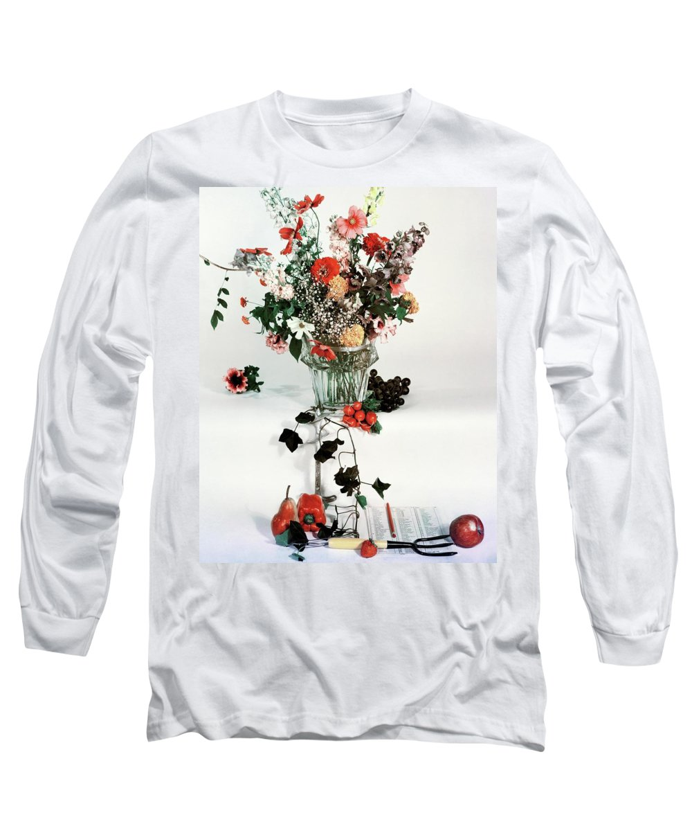 Nobody Long Sleeve T-Shirt featuring the photograph A Studio Shot Of A Vase Of Flowers And A Garden by Herbert Matter