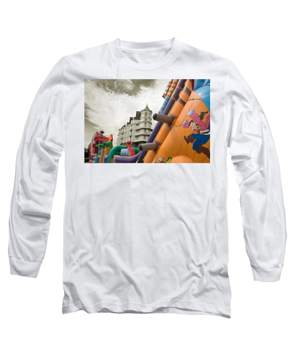 Childrens Long Sleeve T-Shirt featuring the photograph Childrens Play Areas Contrast With The Victorian Elegance Of The Grand Hotel In Llandudno Wales Uk by Mal Bray
