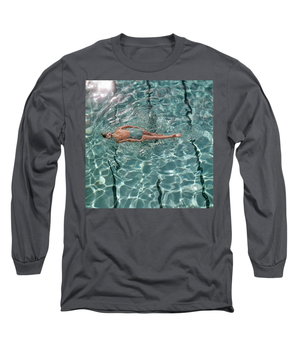 Water Long Sleeve T-Shirt featuring the photograph A Woman Swimming In A Pool by Fred Lyon