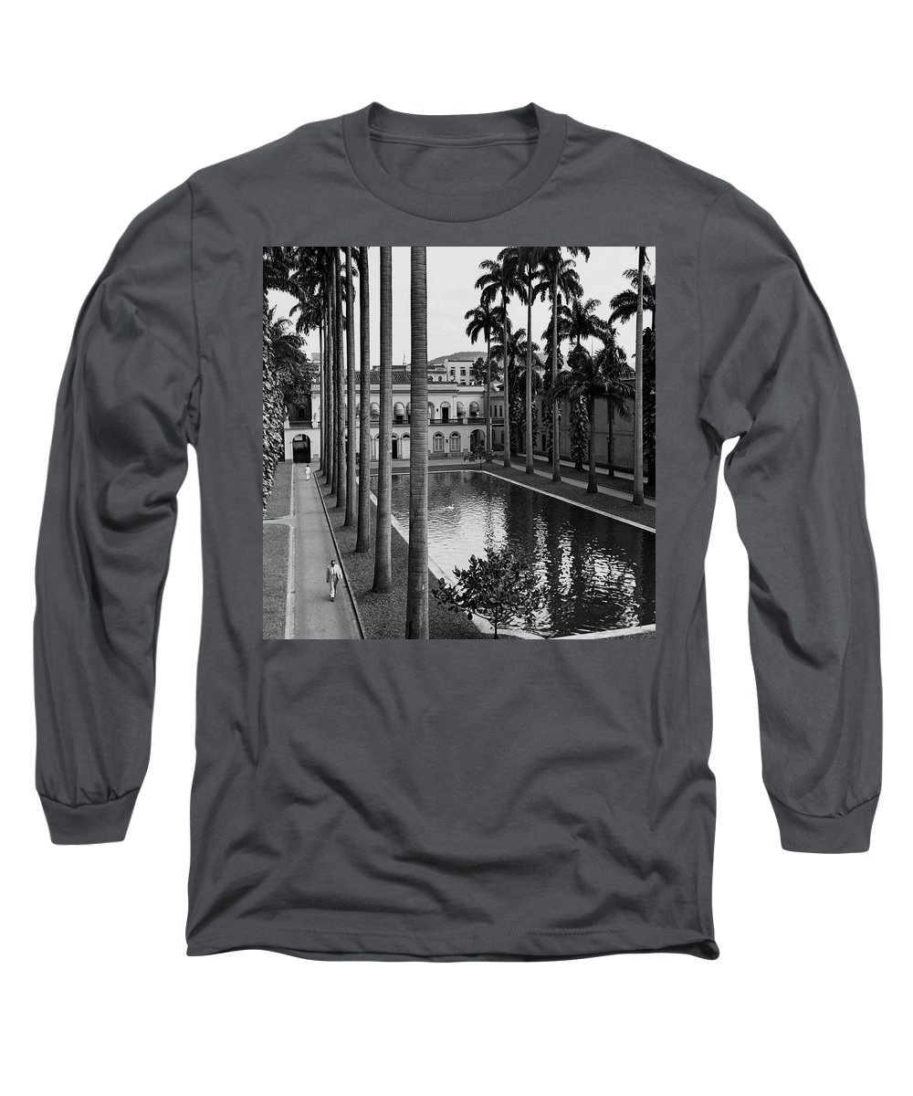 Exterior Long Sleeve T-Shirt featuring the photograph Palm Trees Bordering A Pool by Luis Lemus