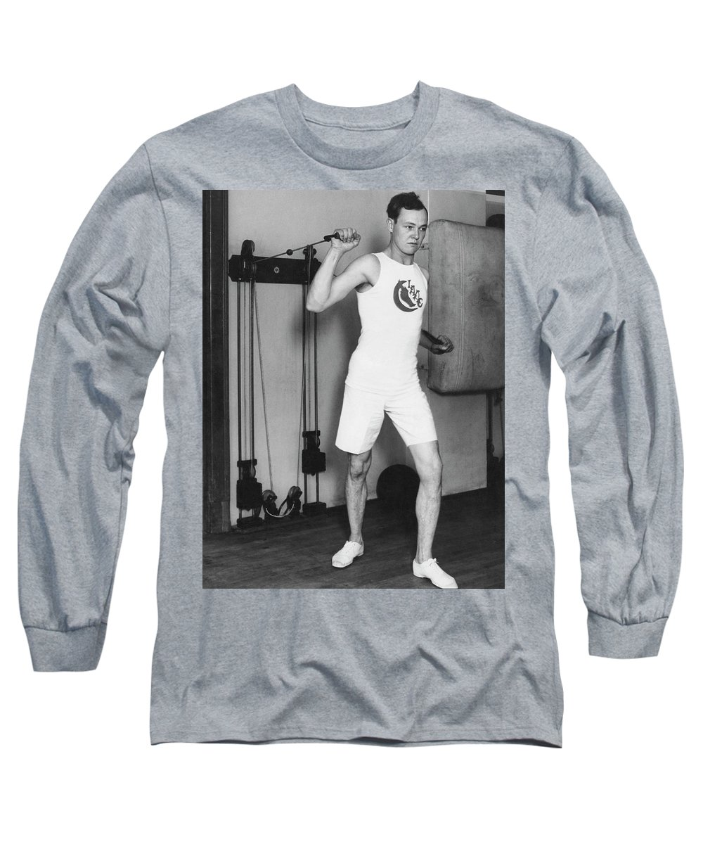 1 Person Long Sleeve T-Shirt featuring the photograph Exercising With Weights 2 by Underwood Archives