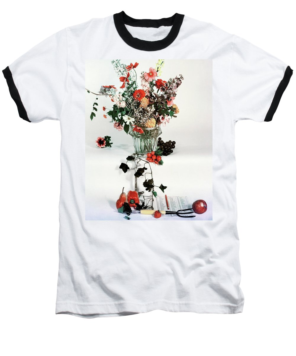 Nobody Baseball T-Shirt featuring the photograph A Studio Shot Of A Vase Of Flowers And A Garden by Herbert Matter