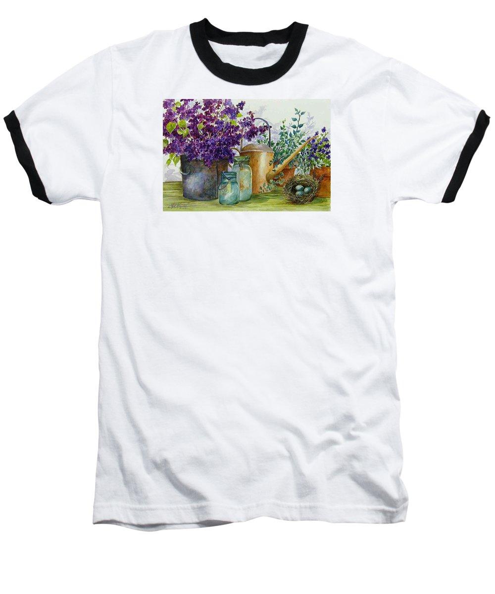 Still Life;lilacs; Ball Jars; Watering Can;bird Nest; Bird Eggs; Baseball T-Shirt featuring the painting Lilacs And Ball Jars by Lois Mountz