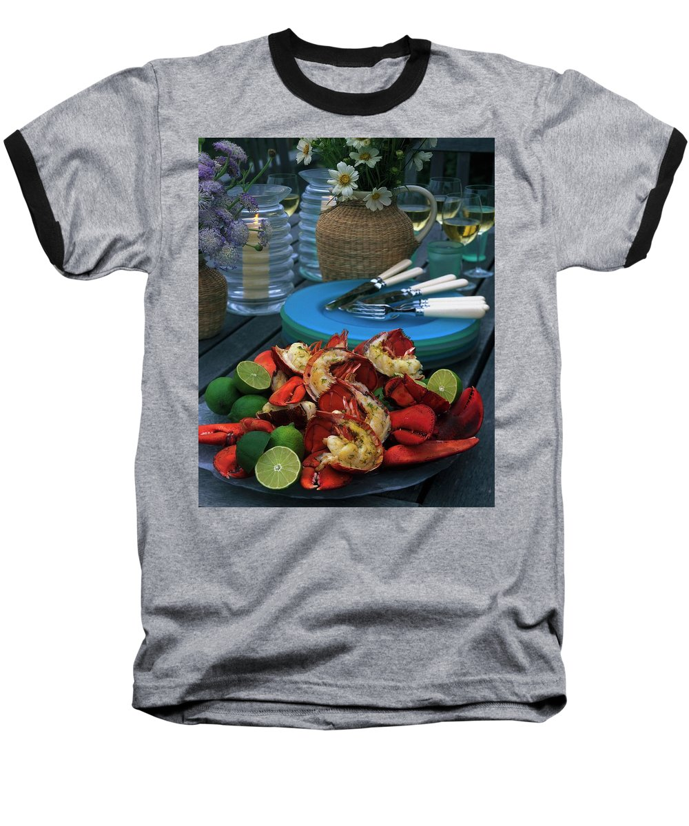 Still Life Baseball T-Shirt featuring the photograph A Meal With Lobster And Limes by Romulo Yanes