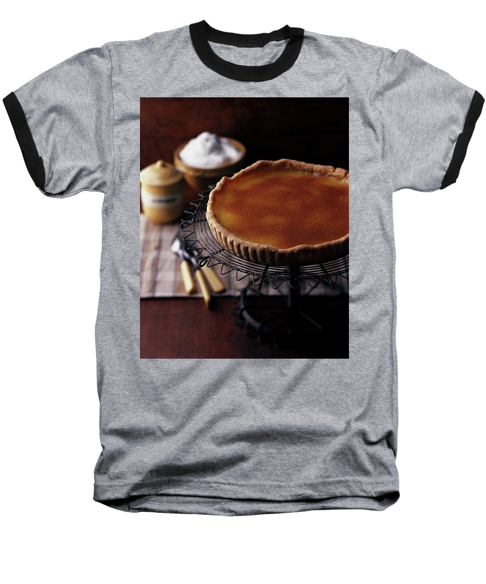 Cooking Baseball T-Shirt featuring the photograph A Vinegar Pie On A Wire Stand by Romulo Yanes