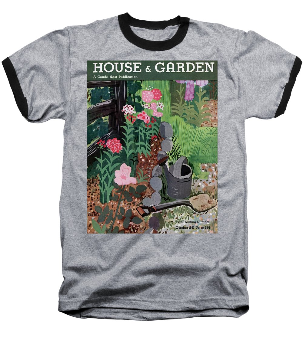 House And Garden Baseball T-Shirt featuring the photograph A Watering Can And A Shovel By A Flower Bed by Witold Gordon