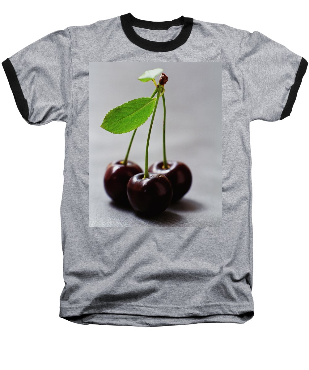 Fruits Baseball T-Shirt featuring the photograph Three Cherries On A Stem by Romulo Yanes