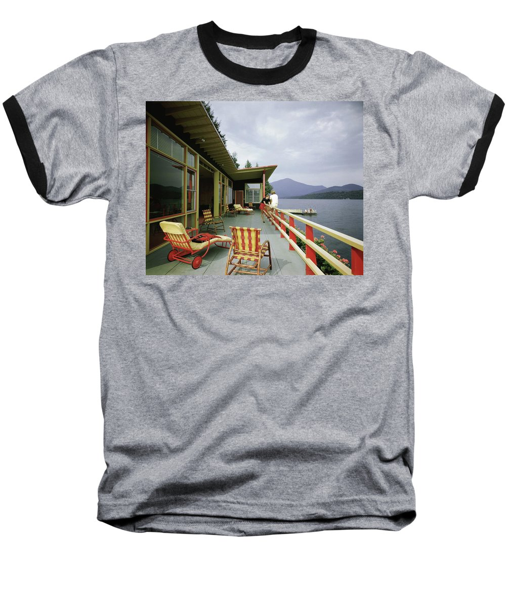 Alfred Rose Baseball T-Shirt featuring the photograph Two Women On The Deck Of A House On A Lake by Robert M. Damora