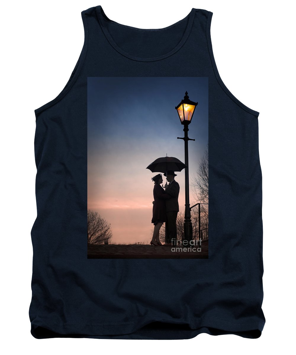Couple Tank Top featuring the photograph Romantic Couple Under A Street Lamp At Sunset by Lee Avison