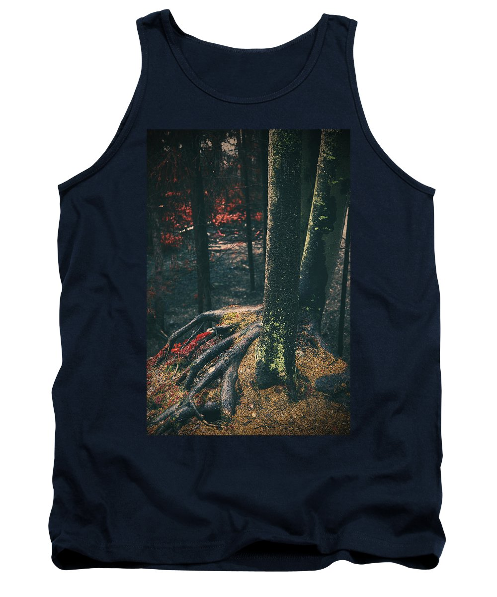 Red Tank Top featuring the photograph Surreal Red Leaves In A Dark Forest Finland by Sandra Rugina