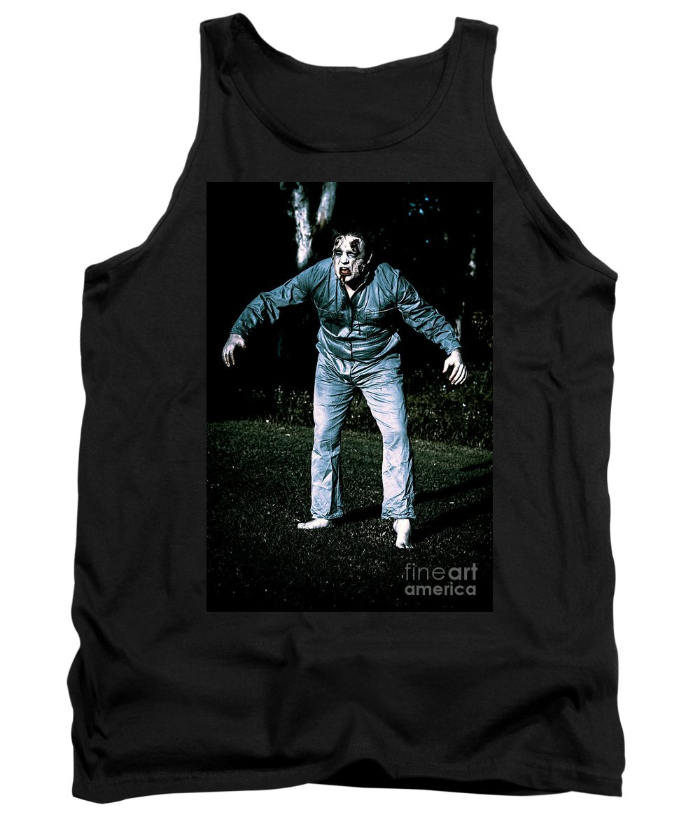Horror Tank Top featuring the photograph Evil Dead Horror Zombie Walking Undead In Cemetery by Jorgo Photography - Wall Art Gallery
