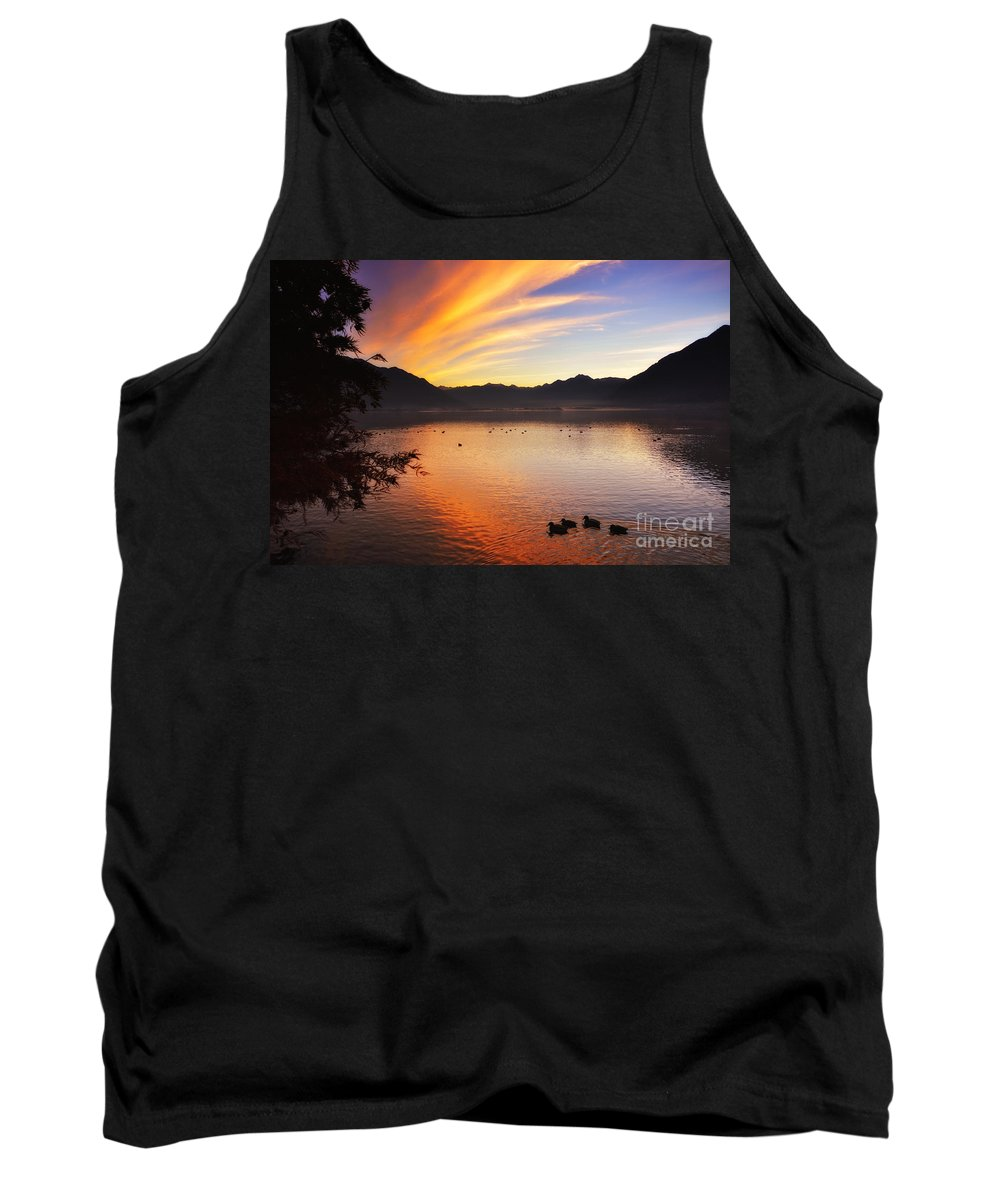 Sunrise Tank Top featuring the photograph Sunrise Over An Alpine Lake by Mats Silvan