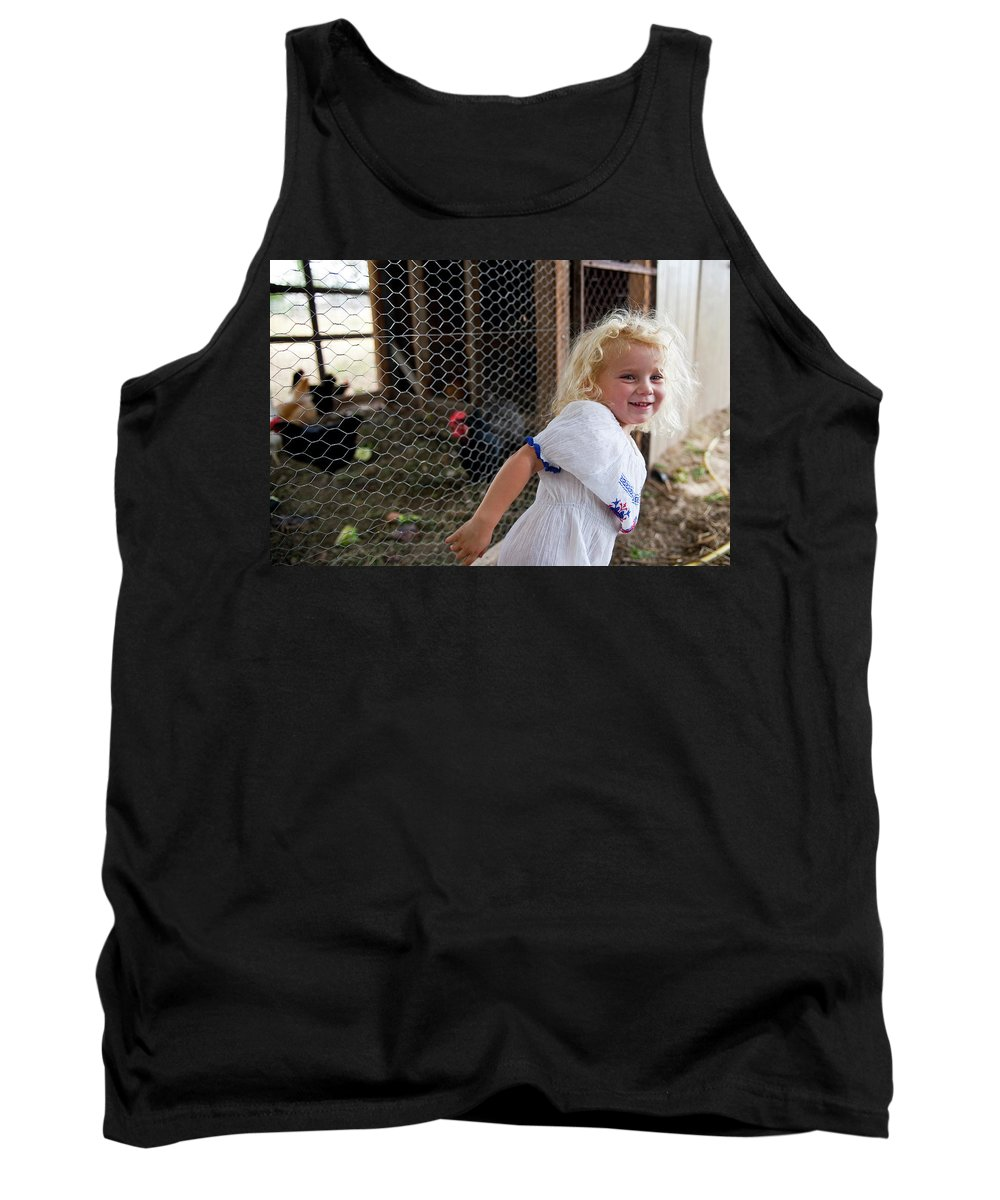 Agriculture Tank Top featuring the photograph A Young Girl Shows Off Her Familys by Chris Noble