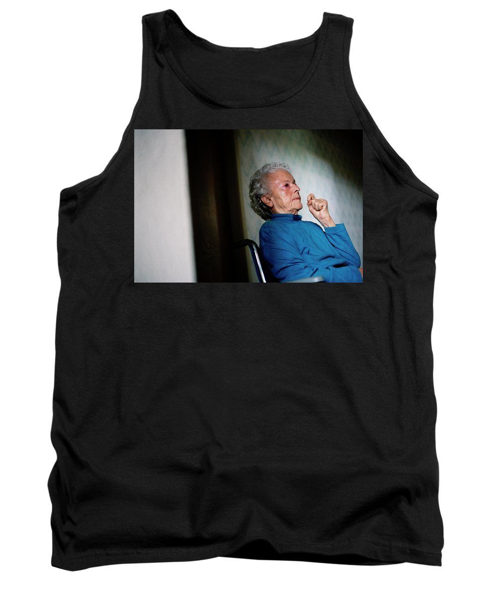 Aging Tank Top featuring the photograph Elderly Woman Sitting In A Wheel Chair by Ron Koeberer