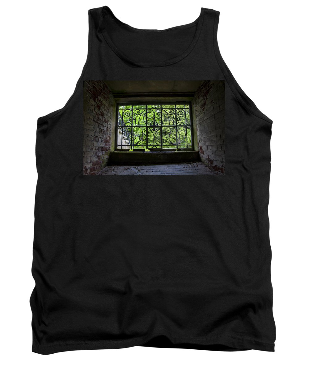 Old Rod Iron Window Tank Top featuring the photograph Looking Through Old Basement Window On To Vibrant Green Foliage Fine Art Photography Print by Jerry Cowart