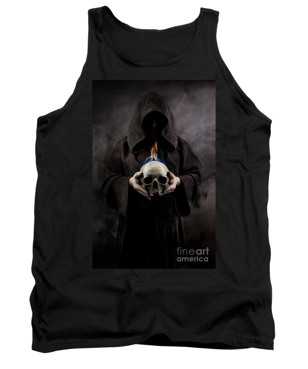 Hood Tank Top featuring the photograph Man In The Hooded Cloak Holding Burning Human Skull In His Hand by Jaroslaw Blaminsky