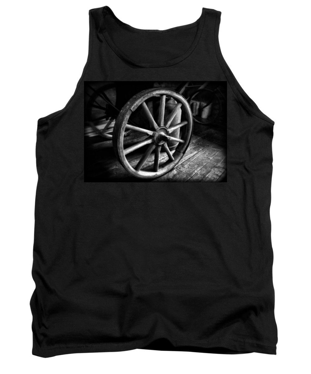 Old Wagon Wheel Black And White Tank Top featuring the photograph Old Wagon Wheel Black And White by Dan Sproul