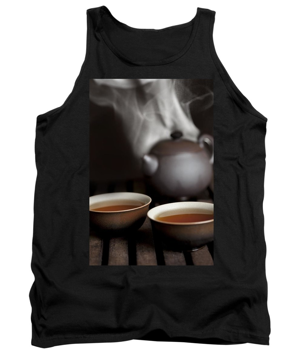 Tank Top featuring the photograph Tea In Cups With A Steaming Pot In The by Mathieu Dupuis