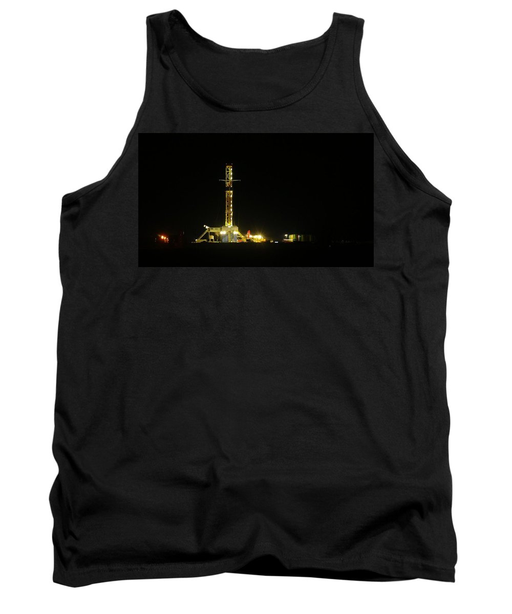 Oil Tank Top featuring the photograph An Oil Rig At Night by Jeff Swan