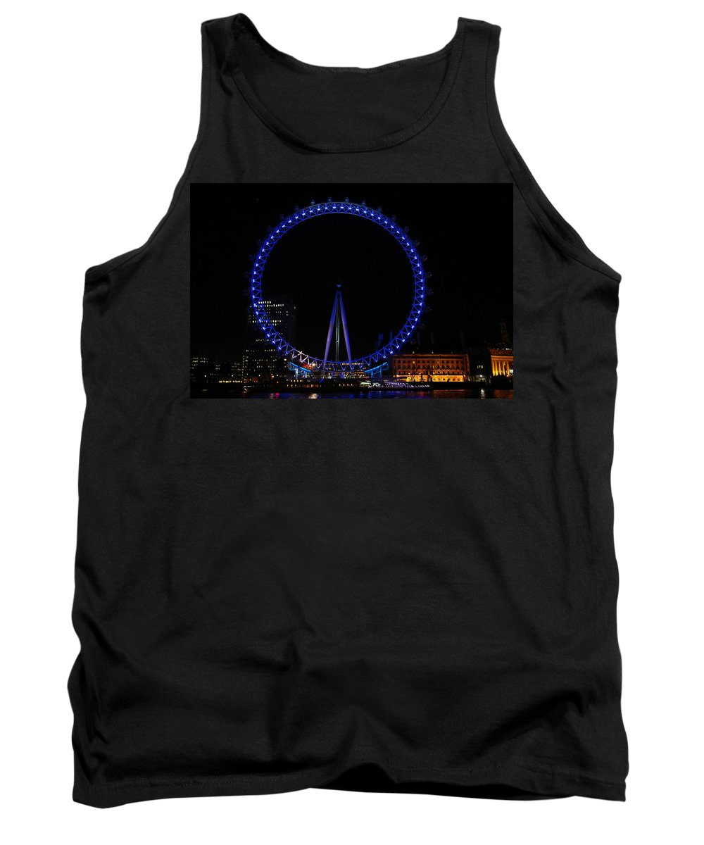 London Tank Top featuring the photograph London Eye All Done Up In Blue Light In The Night With A Small Reflection In The Thames by Ashish Agarwal