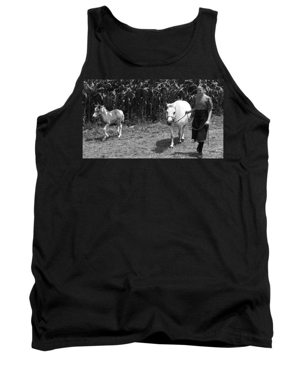Amish Girl With Her Colt Tank Top featuring the photograph Amish Girl With Her Colt by Eric Schiabor