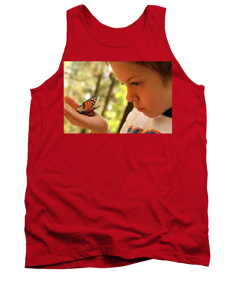 Angangueo Tank Top featuring the photograph A Young Boy Holds A Stick by Robb Kendrick