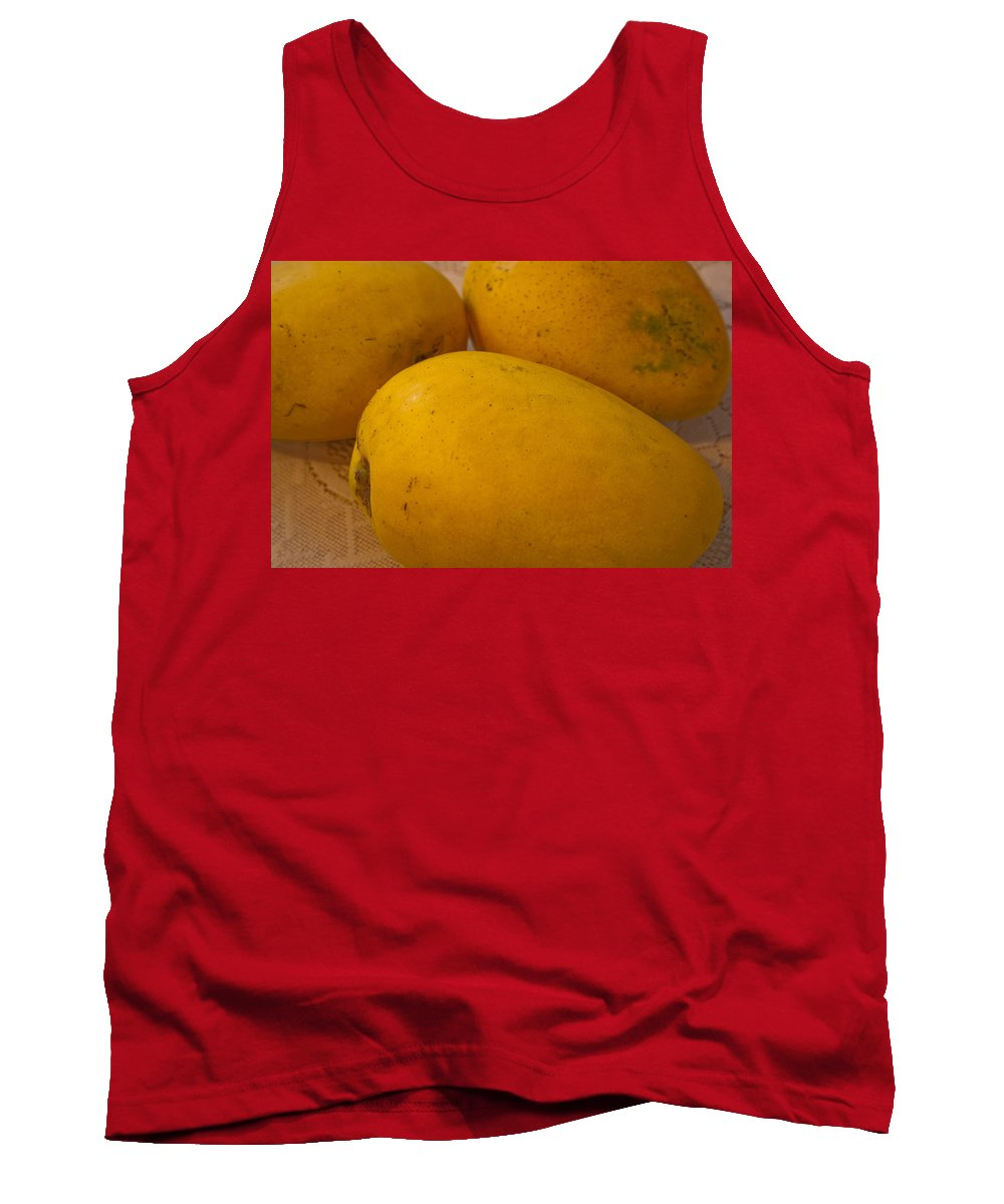 Yellow Tank Top featuring the photograph 3 Yellow And Luscious Mangos On A White Sheet by Ashish Agarwal