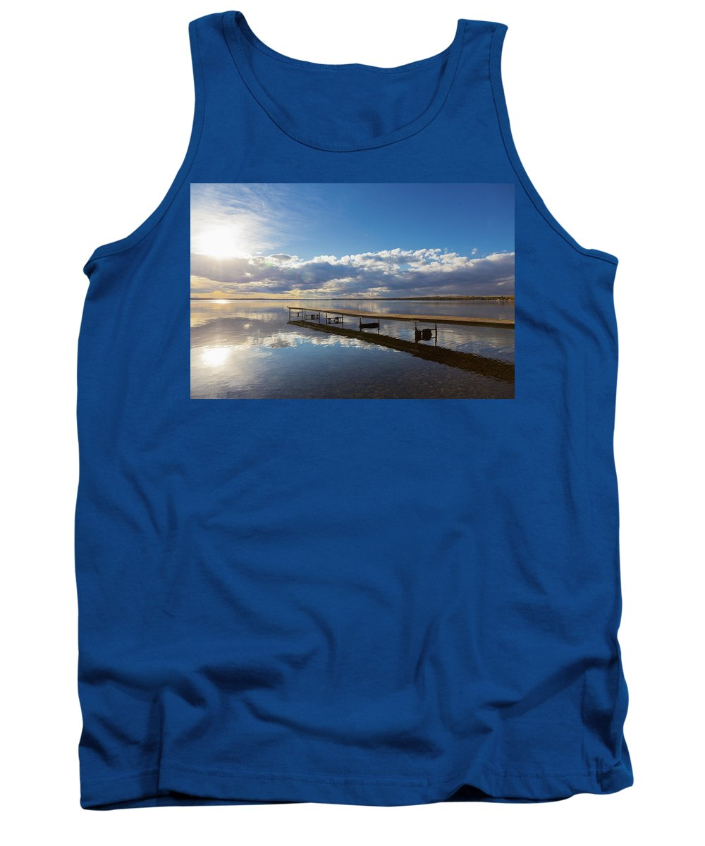 Blue Sky Tank Top featuring the photograph A Dock Leading Out Into The Lake At by Steve Nagy