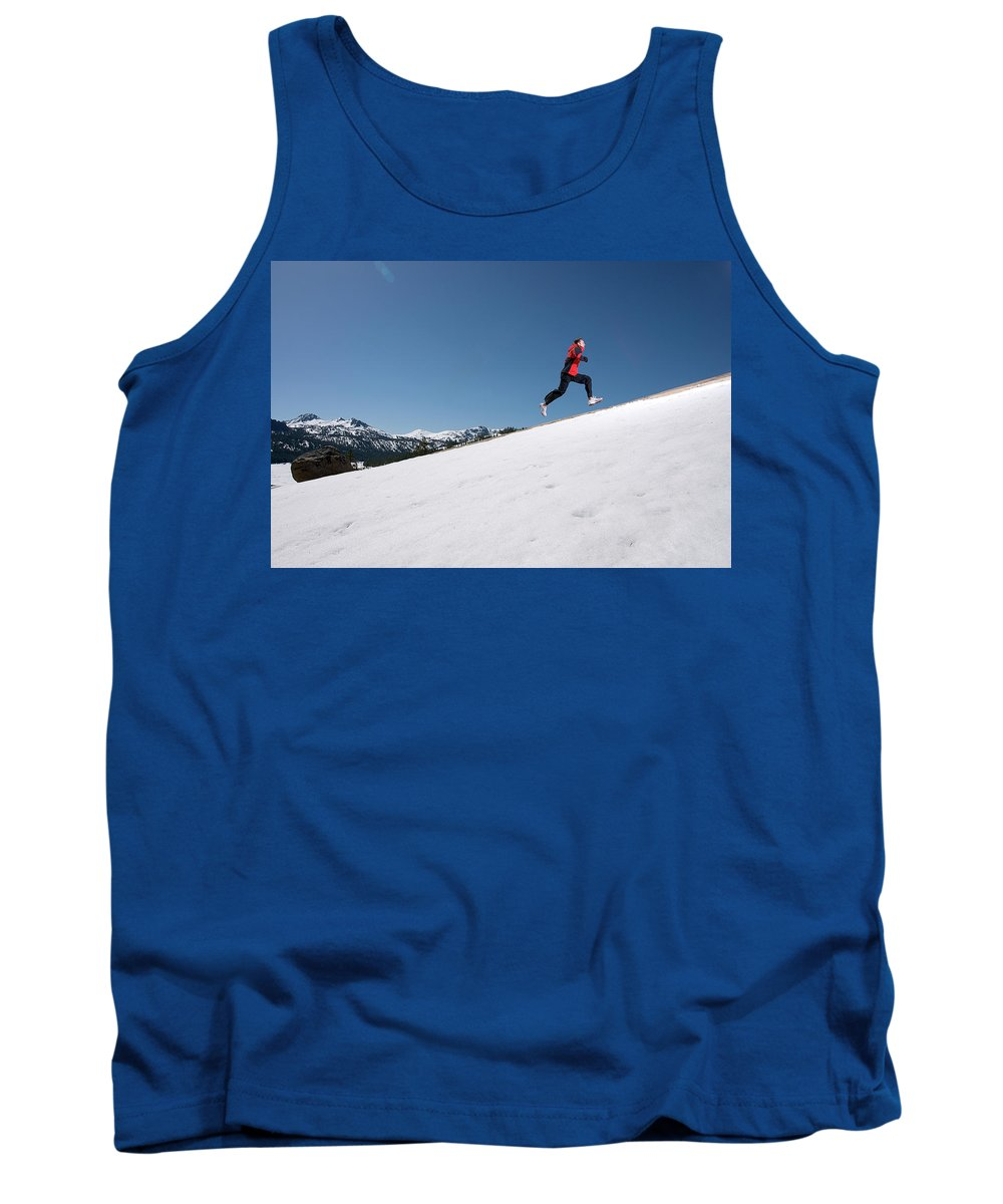 California Tank Top featuring the photograph A Man Runs Alone On A Late Winter Day by Corey Rich