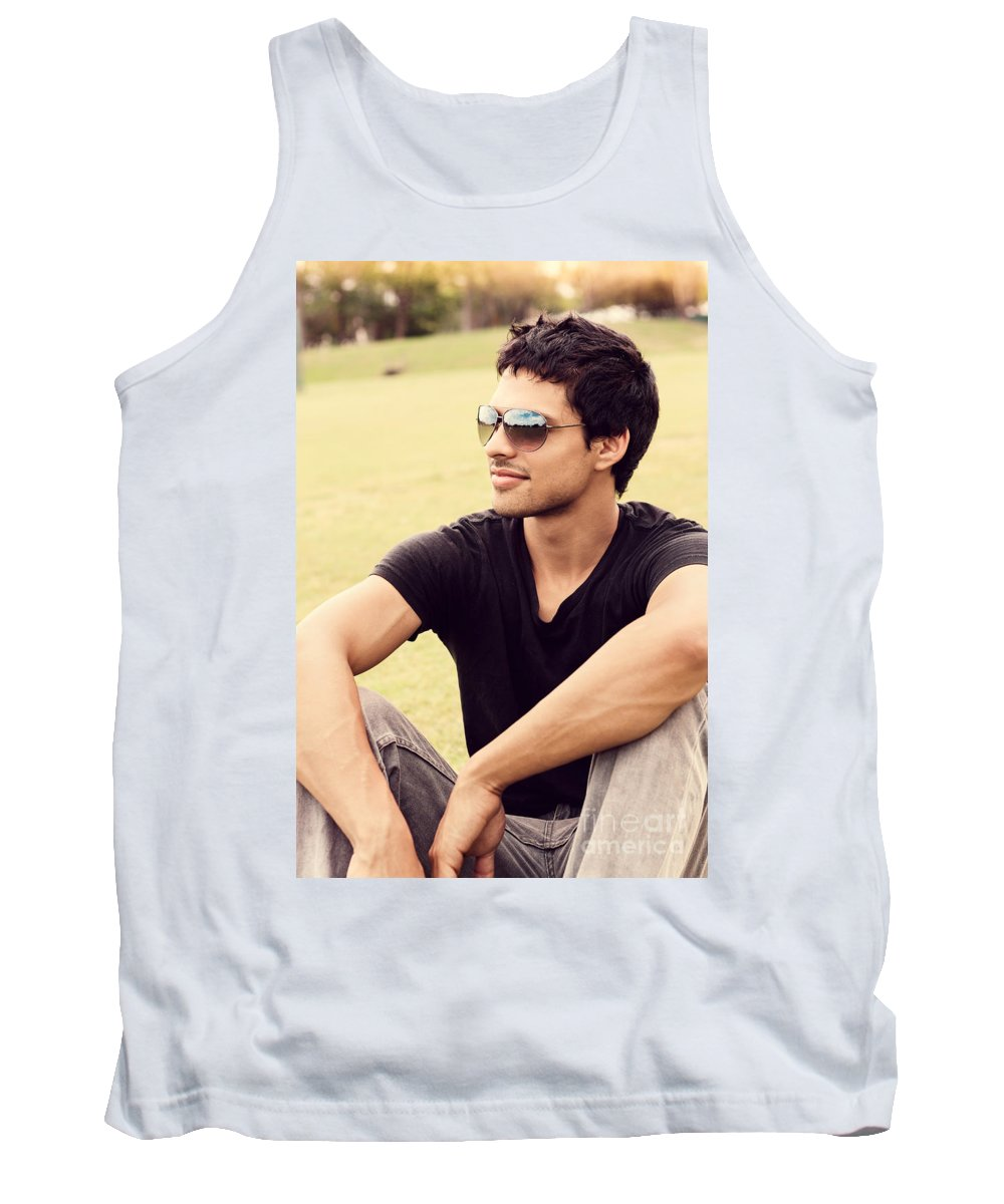 Man Tank Top featuring the photograph Man In Twenties Relaxing Outside On Green Grass by Jorgo Photography - Wall Art Gallery