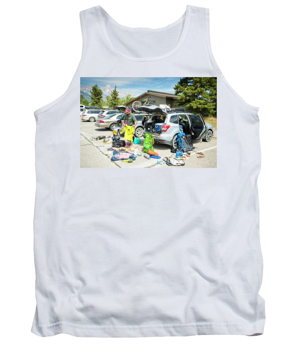 Day Tank Top featuring the photograph A Backpacker Prepares His Gear by Rob Hammer