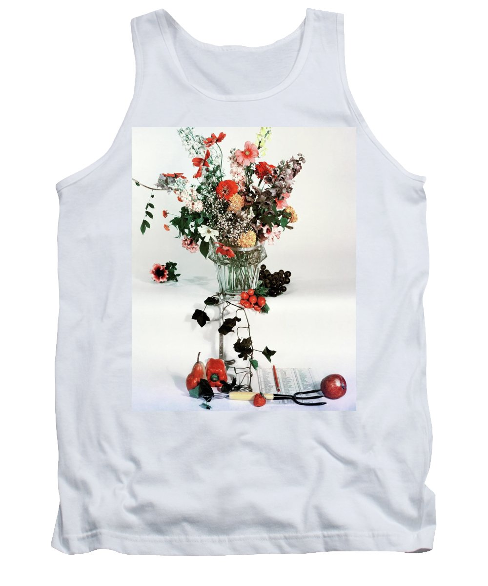 Nobody Tank Top featuring the photograph A Studio Shot Of A Vase Of Flowers And A Garden by Herbert Matter