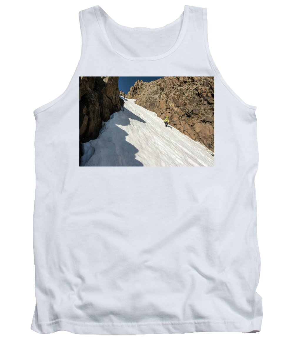 Low Angle View Tank Top featuring the photograph A Woman Descending A Snow Slope While by Kennan Harvey