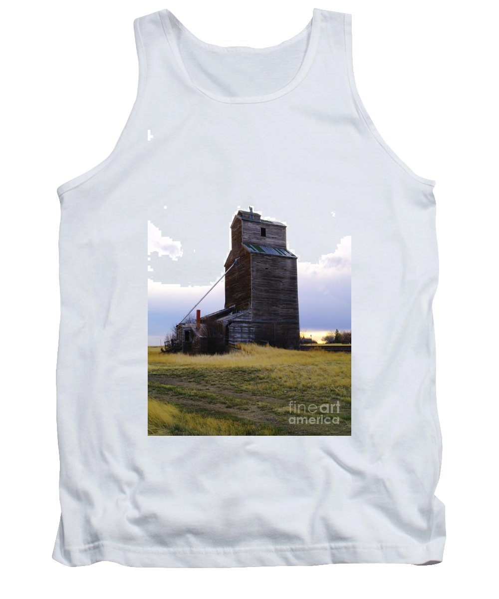 Grain Elevators Tank Top featuring the photograph An Old Grain Elevator Off Highway Two In Montana by Jeff Swan