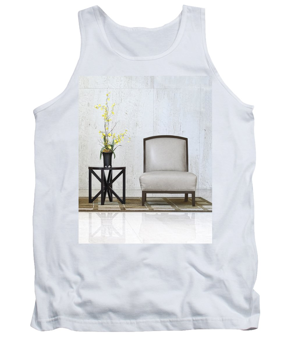 Table Tank Top featuring the photograph A Chair And A Table With A Plant by Rudy Umans