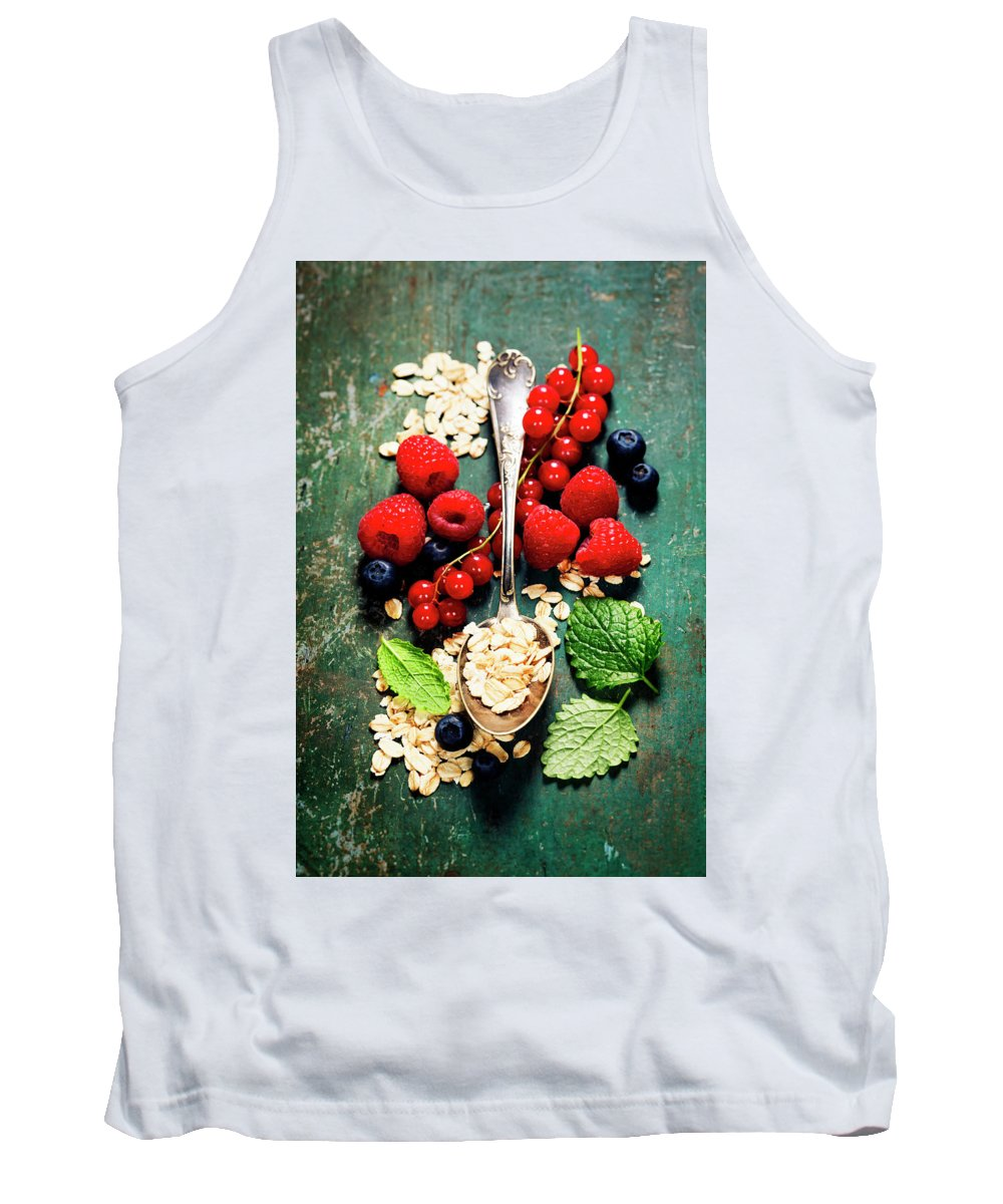 Oat Tank Top featuring the photograph Breakfast With Oats And Berries by Natalia Klenova