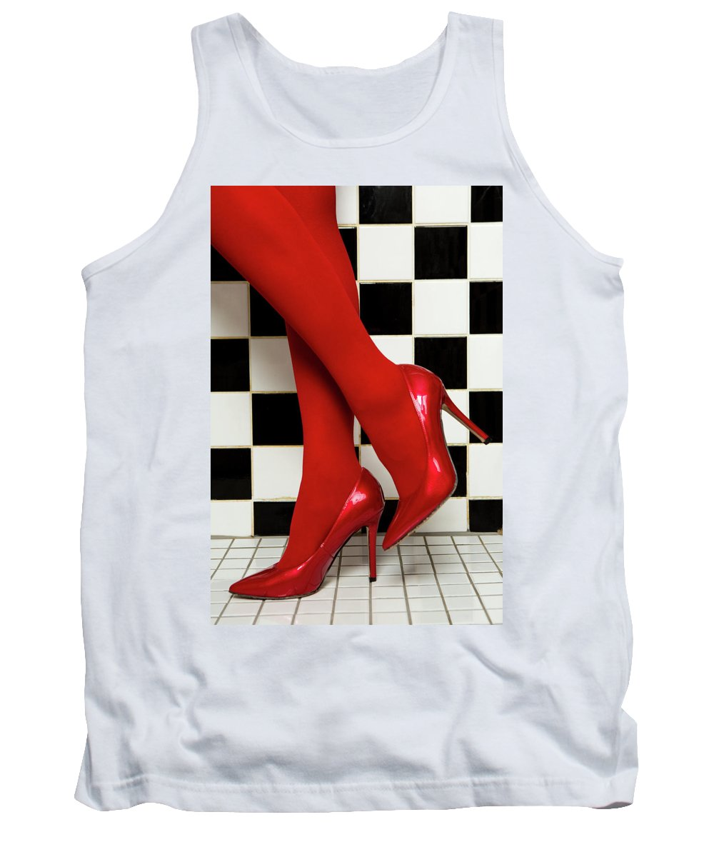 Background Tank Top featuring the photograph Female Legs In Red Pantyhose And Shoes On High Heels On A Background by Elena Saulich