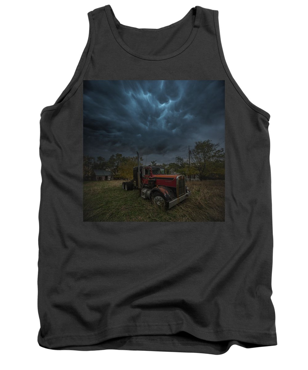 #storm #forgotten #semi #truck #abandoned #farm #country #southdakota #hifromsd #mammutusclouds #homegroenphotography #aarongroen #usa Tank Top featuring the photograph End Of The Road by Aaron J Groen