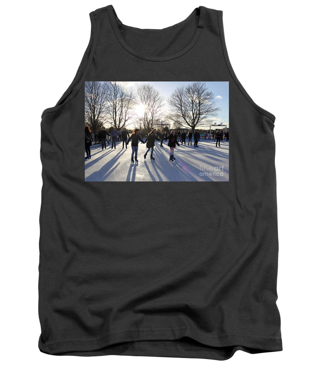 Ice Skating At Hampton Court Palace Ice Rink England Uk Tank Top featuring the photograph Ice Skating At Hampton Court Palace Ice Rink England Uk by Julia Gavin