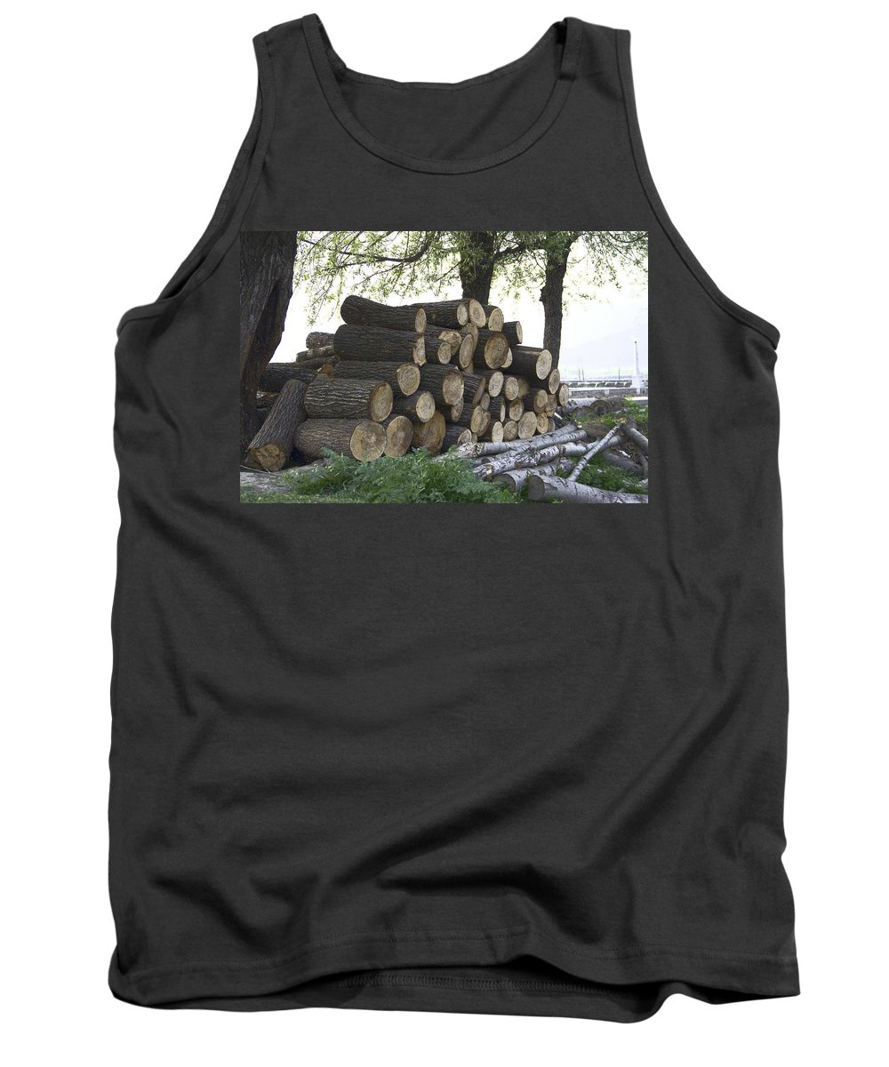 Canon Tank Top featuring the digital art Cut Tree Trunks Piled Up For Further Processing After Logging by Ashish Agarwal